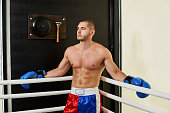 Boxer man standing in a corner of the ring