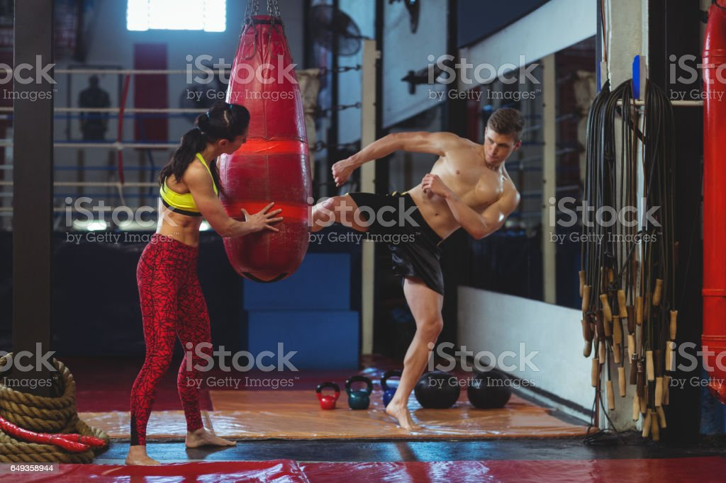 Boxer practicing a kick boxing stock photo