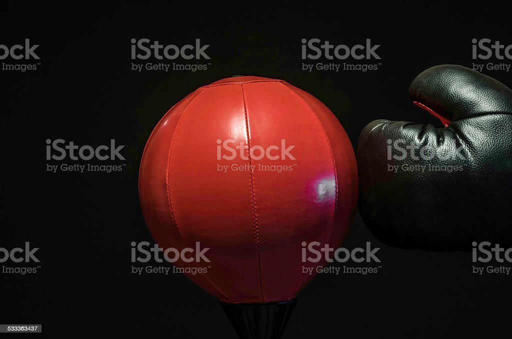 boxer punching a swing ball, studio isolated, colour image stock photo
