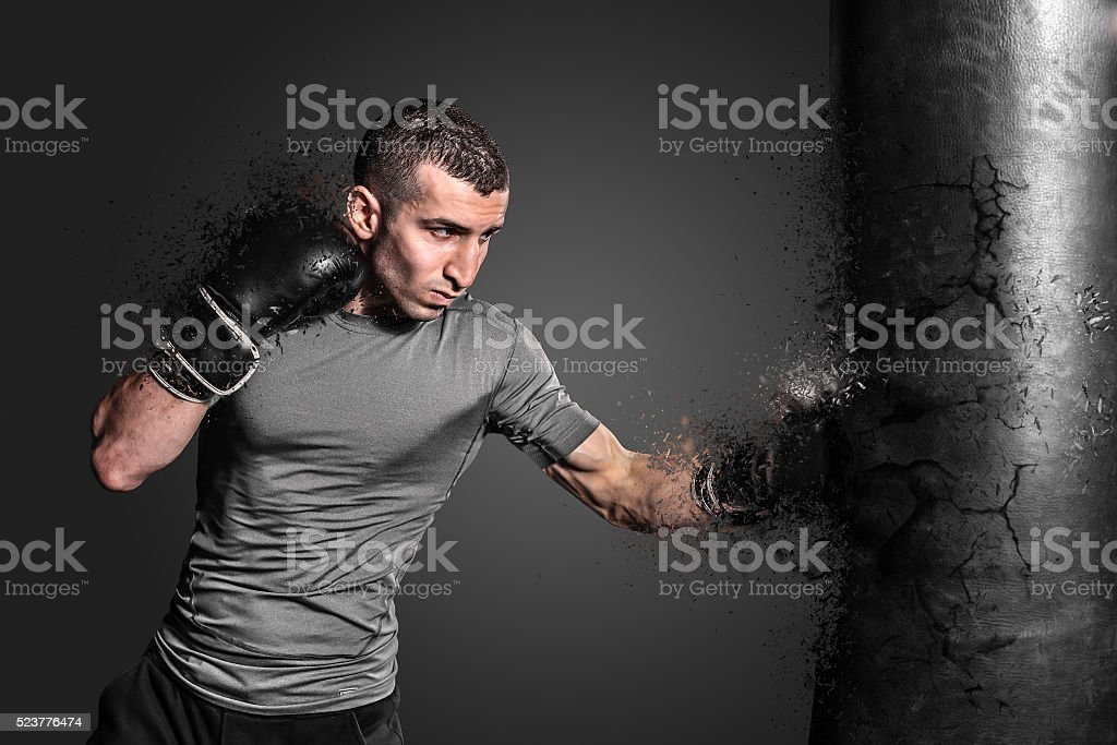 Boxer punching bag blow to the explosion stock photo