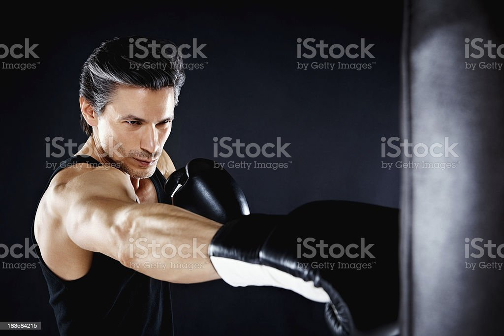 Boxer throwing right hook royalty-free stock photo