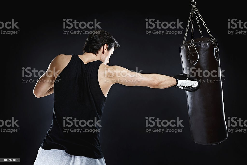 Boxer throwing right punch stock photo