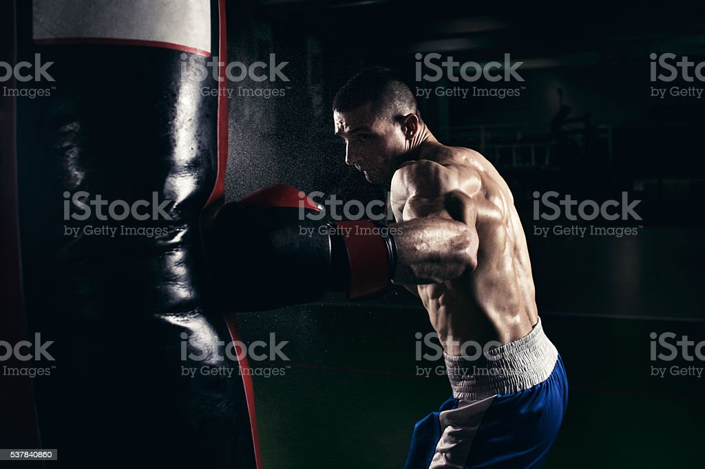 Boxer training with a punching bag stock photo
