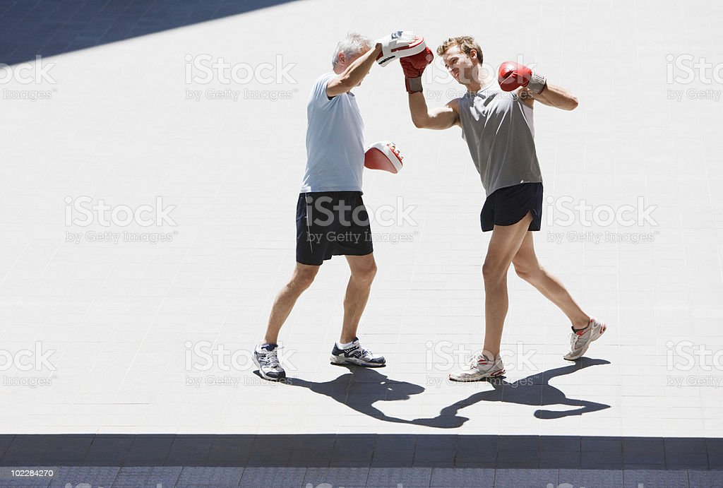 Boxer training with coach outdoors royalty-free stock photo