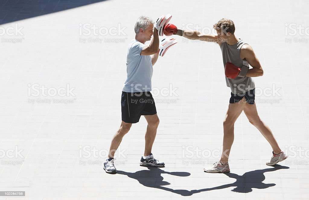 Boxer training with coach outdoors stock photo