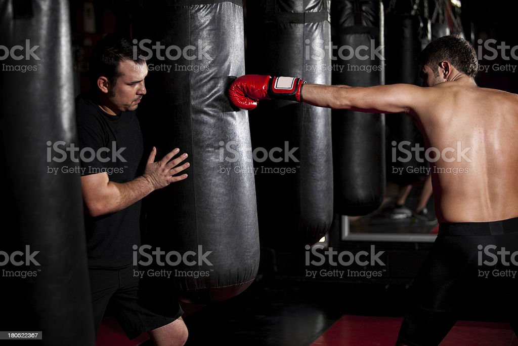 Boxer training with his coach royalty-free stock photo