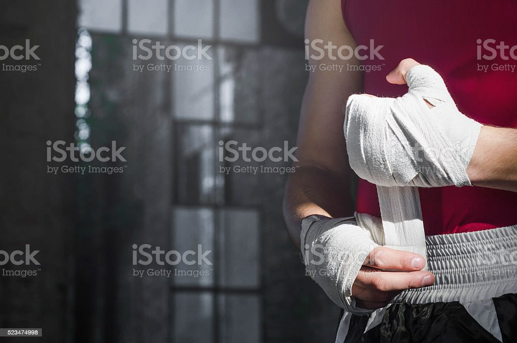 Boxer turning bandages stock photo