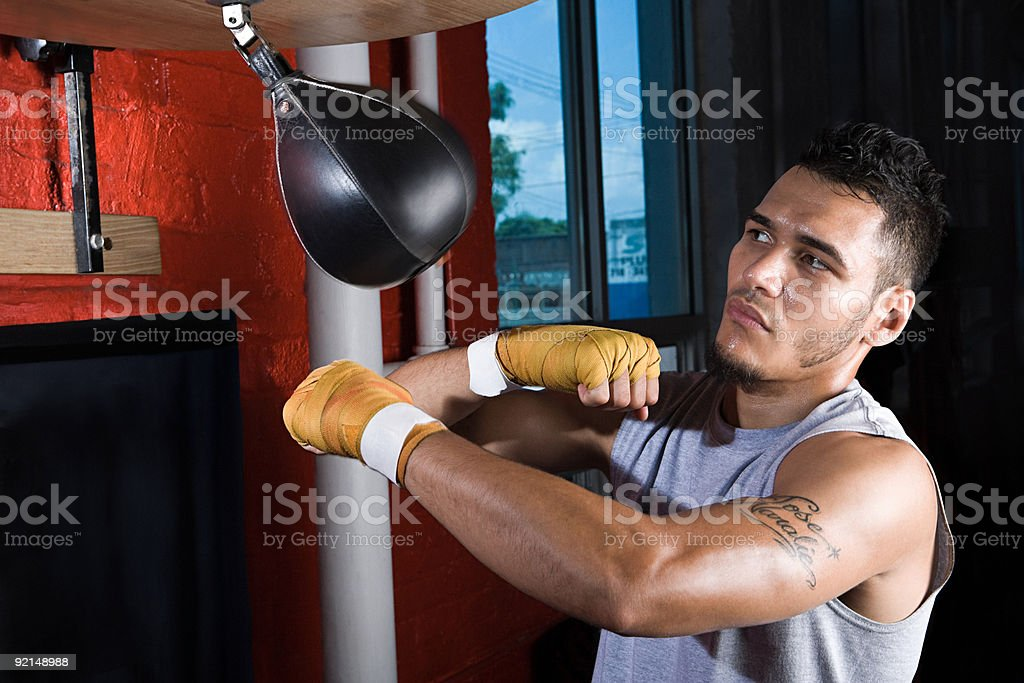 Boxer using punchbag stock photo