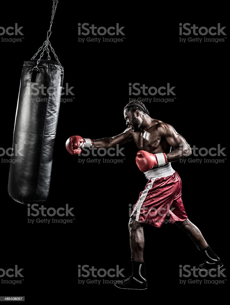 Boxer with punching bag stock photo