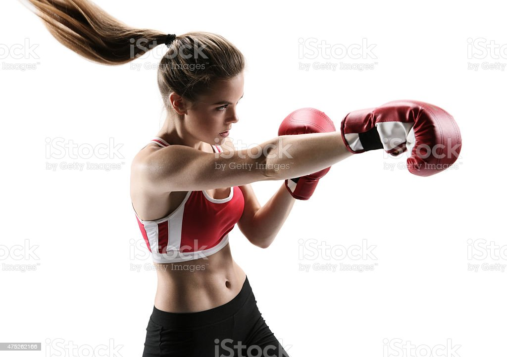 Boxer woman during boxing exercise making direct hit with glove stock photo