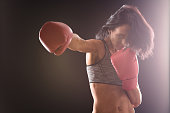 Boxer woman with red boxing gloves on