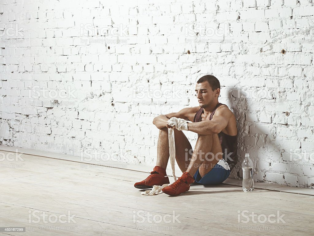 Boxer wrapping his hands royalty-free stock photo