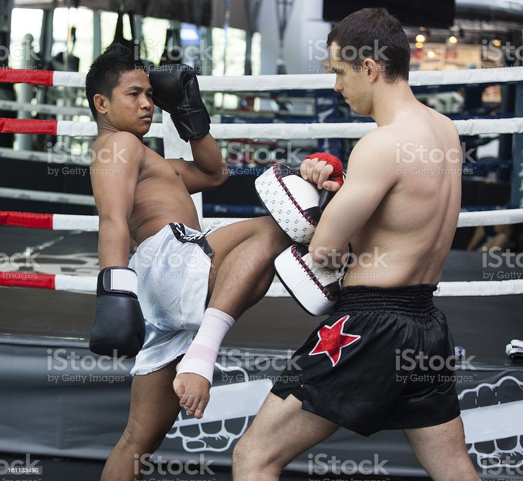 Boxers practicing Thai boxing in the boxing ring stock photo