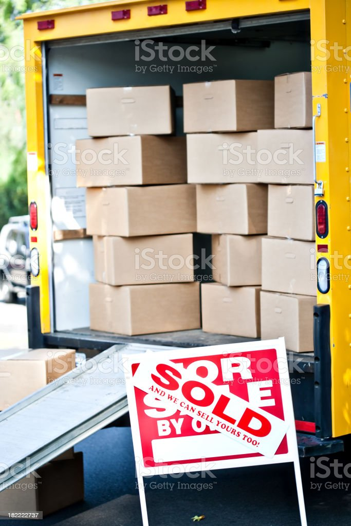 boxes and for sale sign royalty-free stock photo