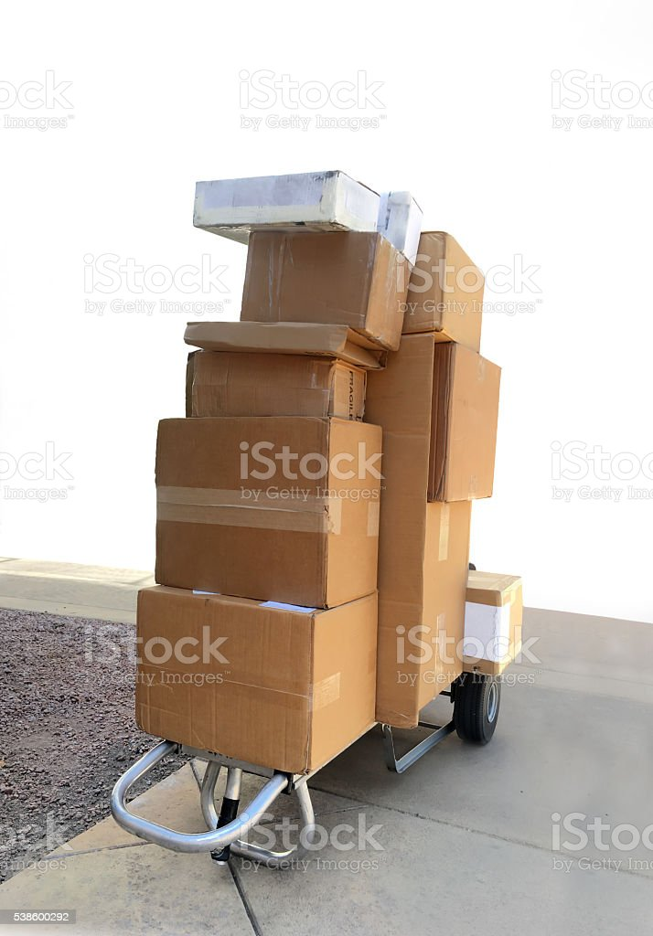 Boxes being delivered on trolley cart stock photo