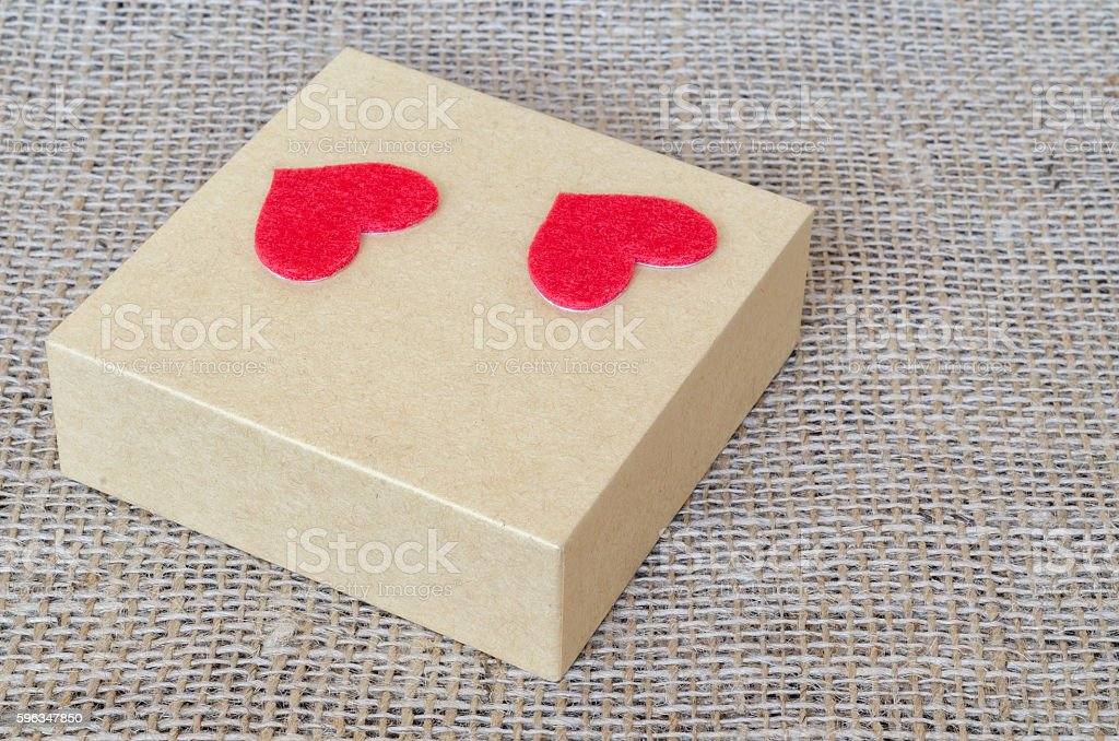 Boxes for gifts and paper heart on the sackcloth stock photo
