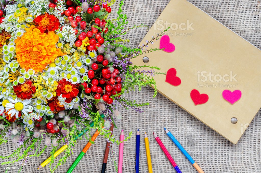 Boxes for gifts with flowers and notebook  pencils  paper stock photo