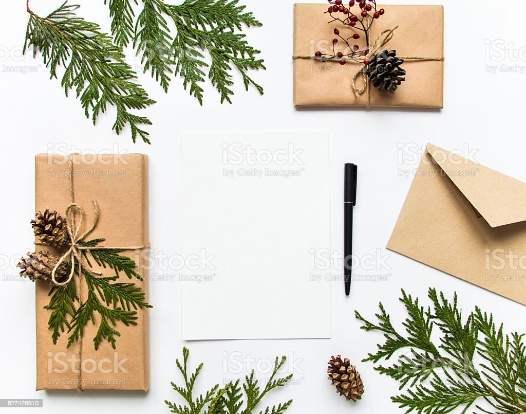 Boxes in eco paper and letter. Holiday concept, top view stock photo