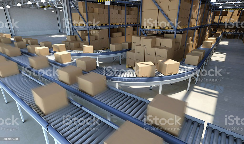 Boxes moving on conveyor belt inside warehouse, ready for delivery stock photo