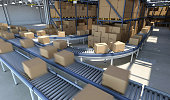 Boxes moving on conveyor belt inside warehouse, ready for delivery
