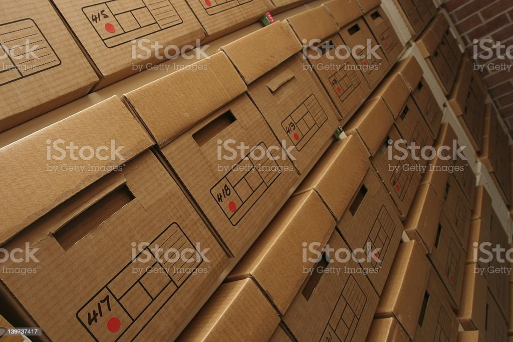 Boxes of company records in archives room stock photo