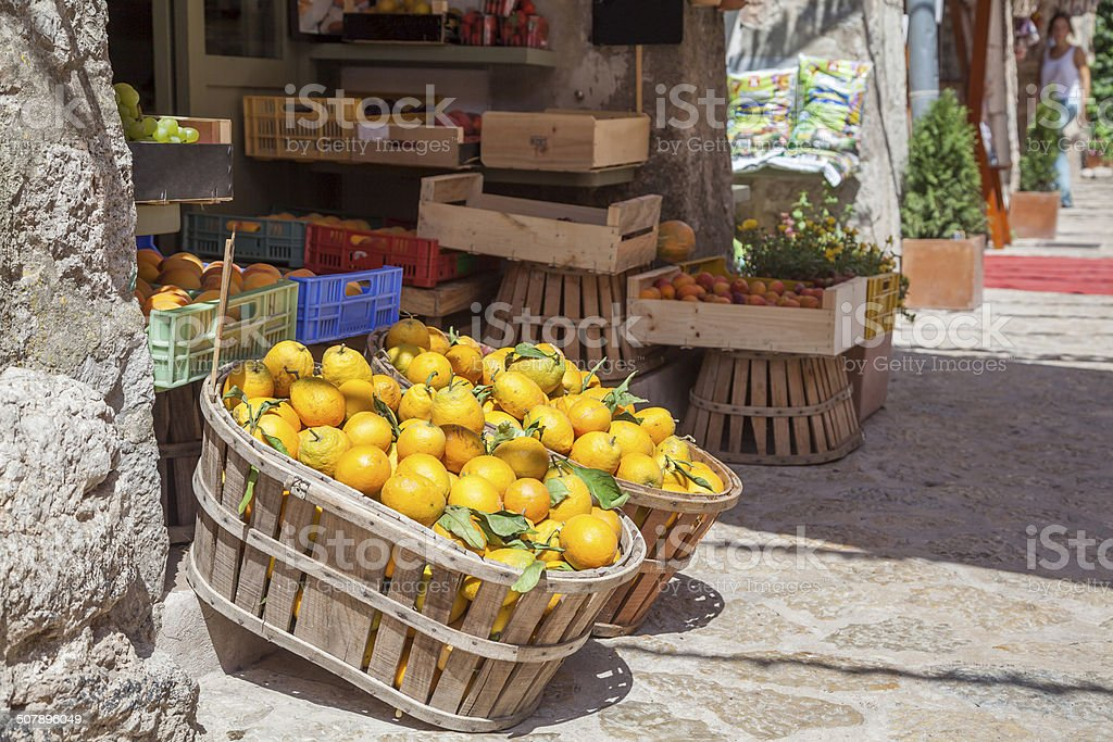Boxes of lemons in a fruit shop stock photo