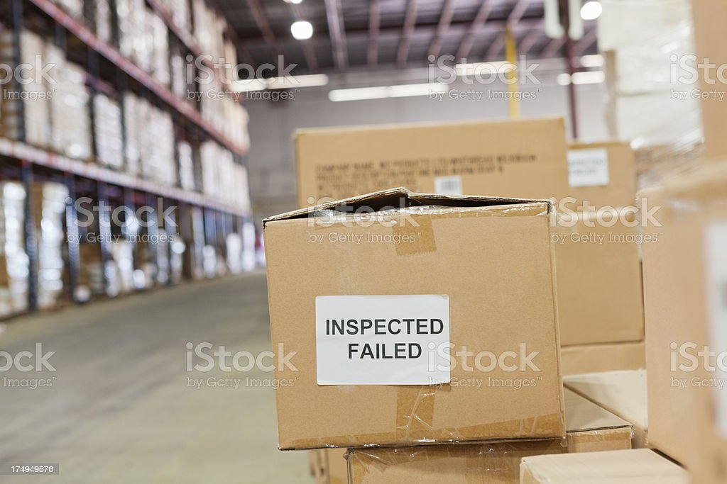 Boxes of products failed inspection at shipping distribution warehouse stock photo