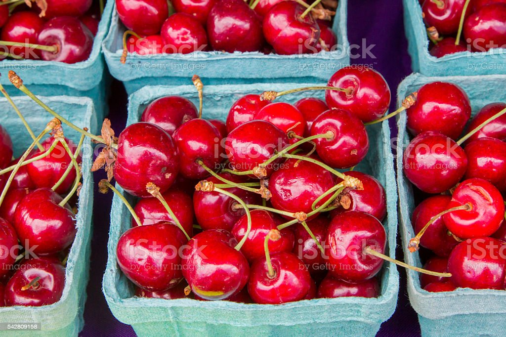 Boxes of sweet red cherries stock photo