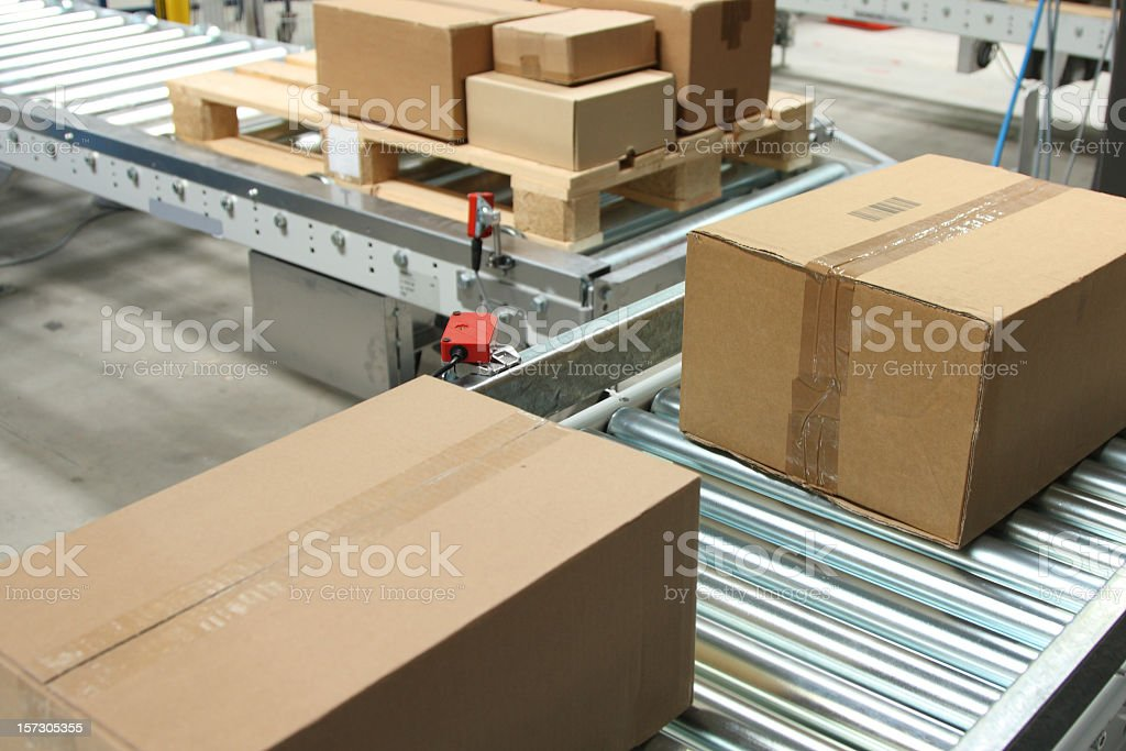 boxes on conveyor belt royalty-free stock photo