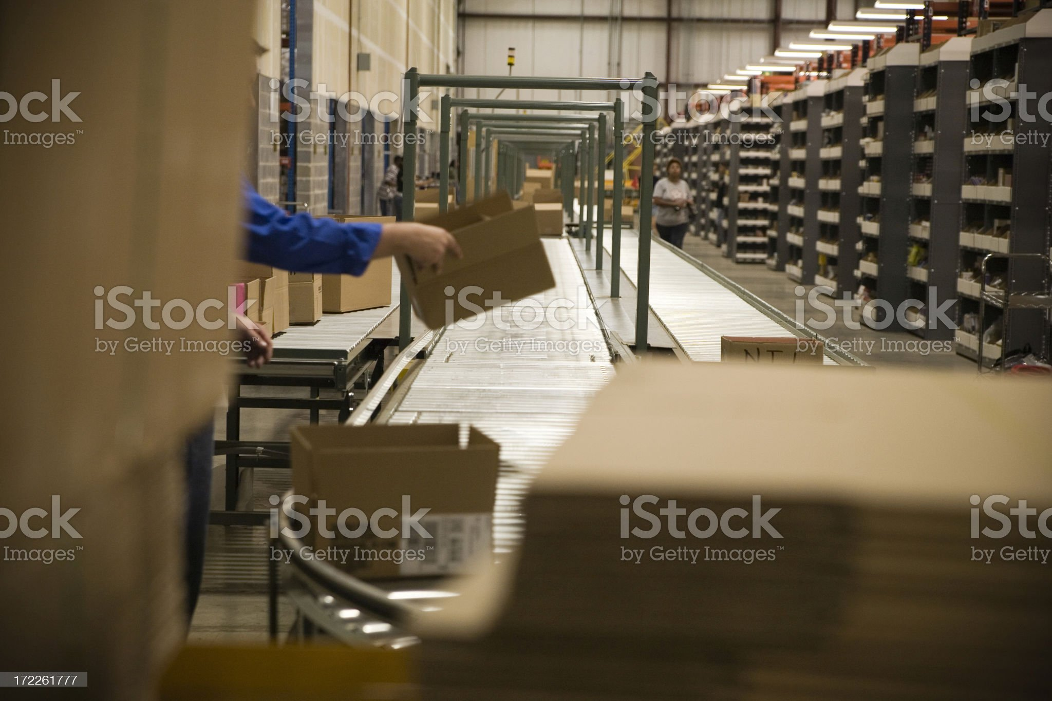 Boxes on conveyor in a warehouse royalty-free stock photo
