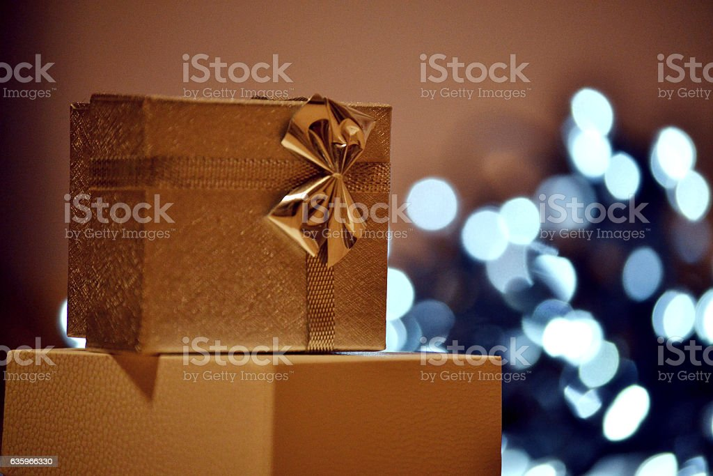 Boxes, presents on brown background with lights stock photo