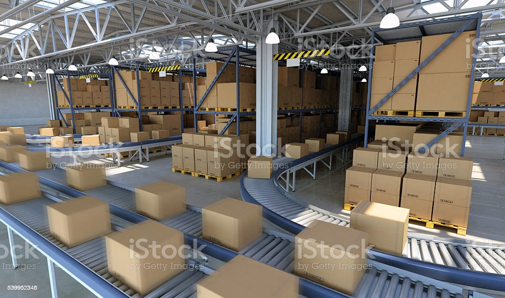 Boxes running on conveyor belt ready for delivery inside warehouse stock photo