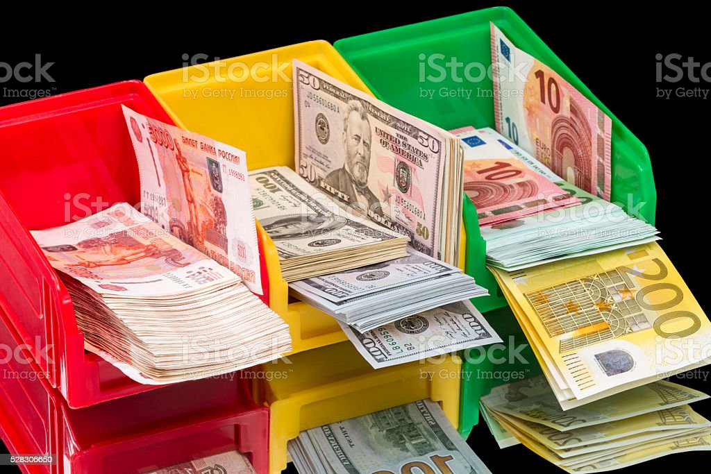 Boxes with three types of currency stock photo