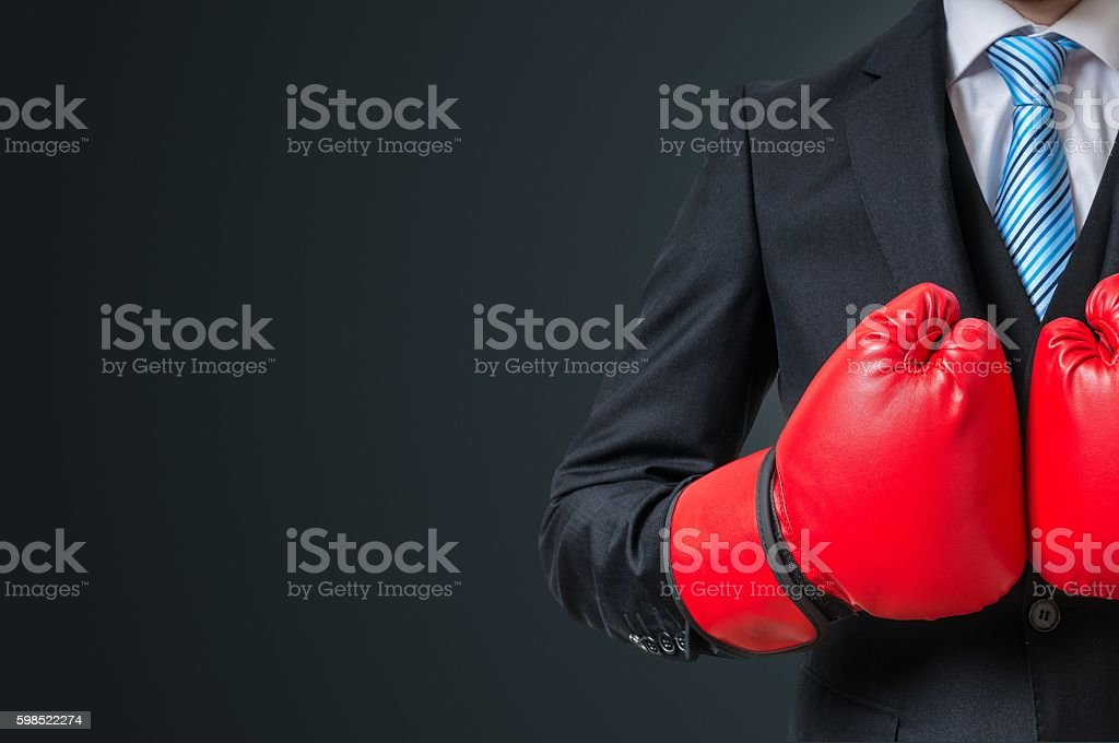 Boxing businessman with red gloves and empty space in background stock photo