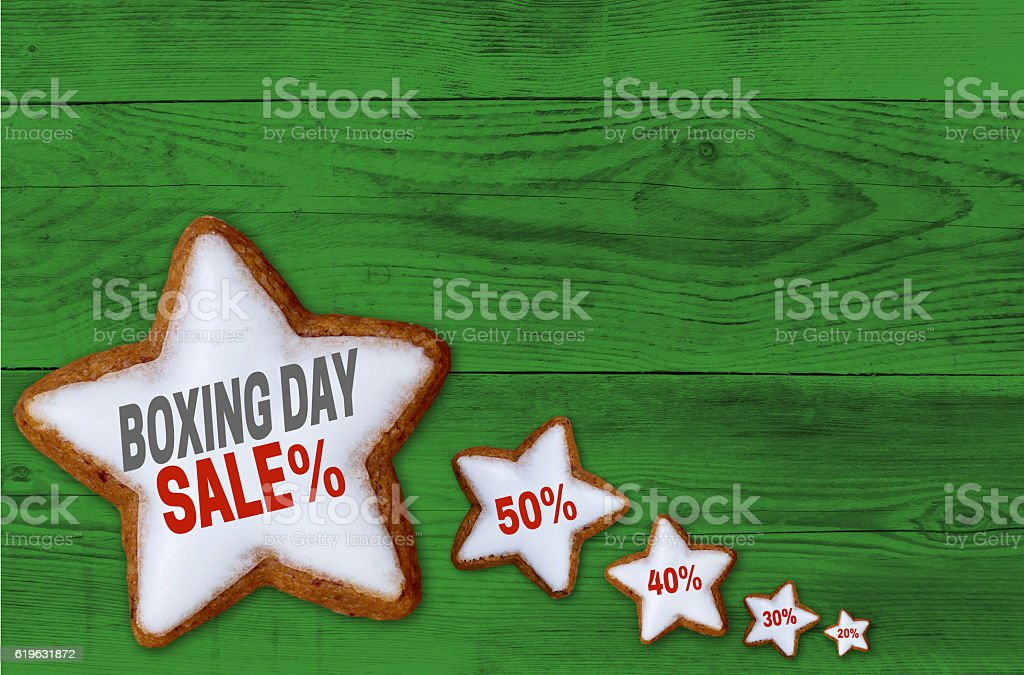 Boxing Day Sale cinnamon star on green wood concept stock photo