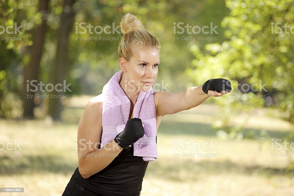 boxing exercise at the park royalty-free stock photo