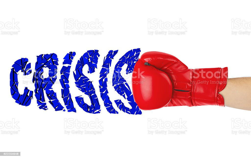 Boxing glove and word Crisis stock photo