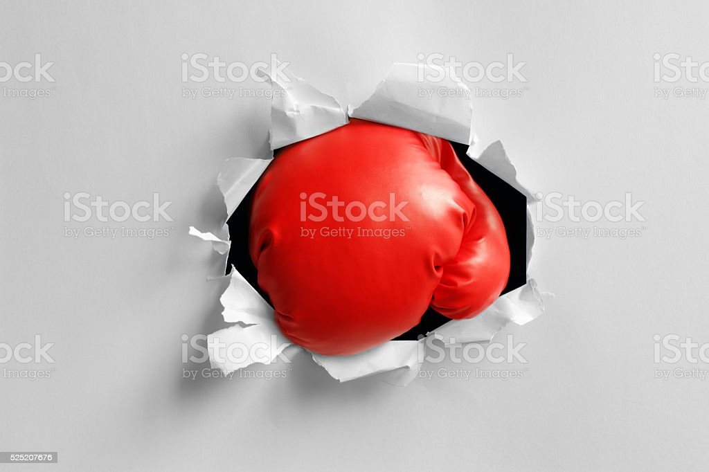 Boxing glove knockout punch stock photo