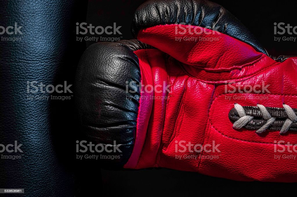 boxing glove punching a punch bag  close up, colour image stock photo