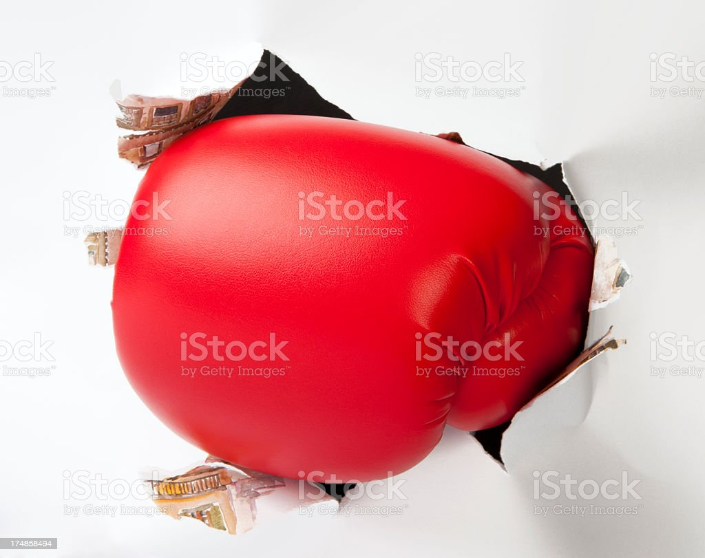Boxing Glove Through the Paper stock photo