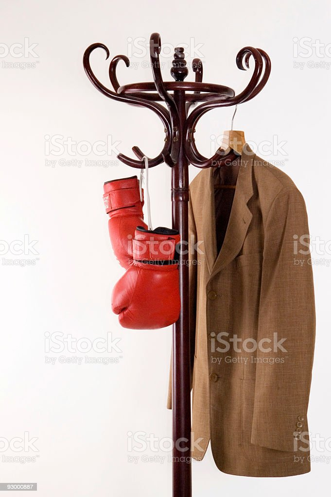 Boxing gloves and  jacket on a hanger royalty-free stock photo