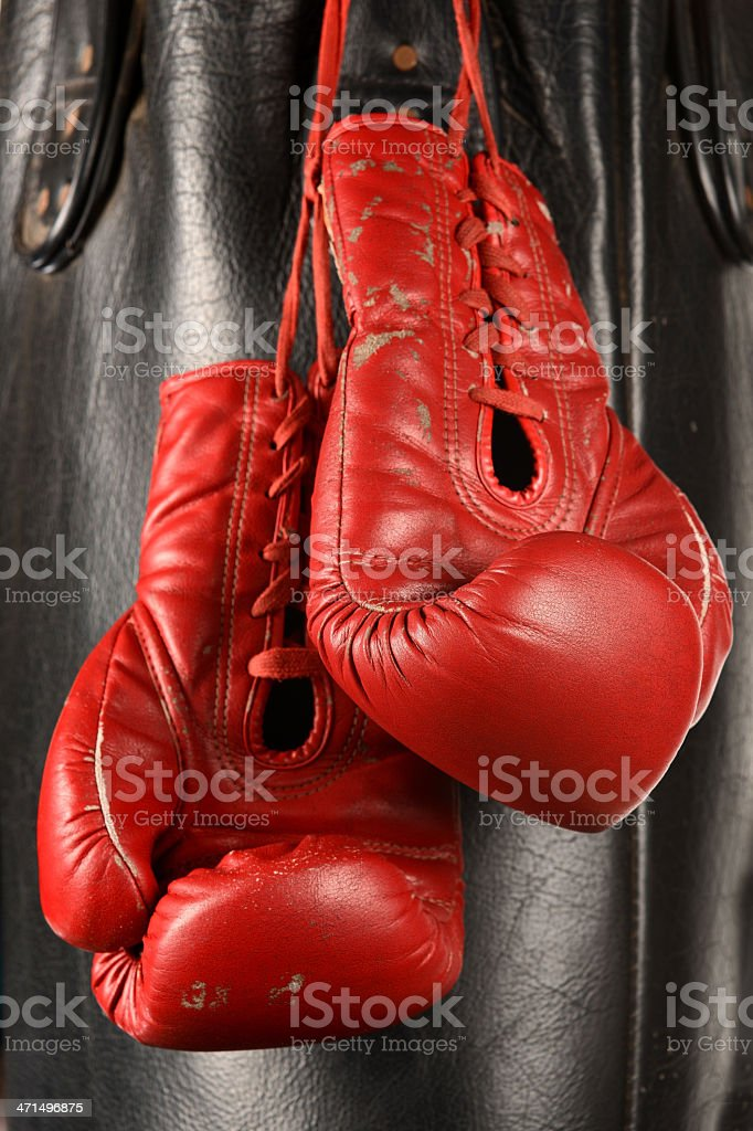 Boxing gloves and punching bag royalty-free stock photo