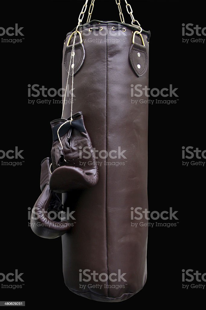 Boxing gloves and punching bag stock photo