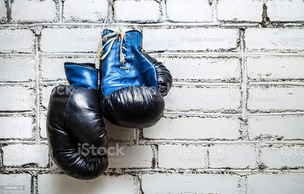 Boxing gloves on brick wall stock photo