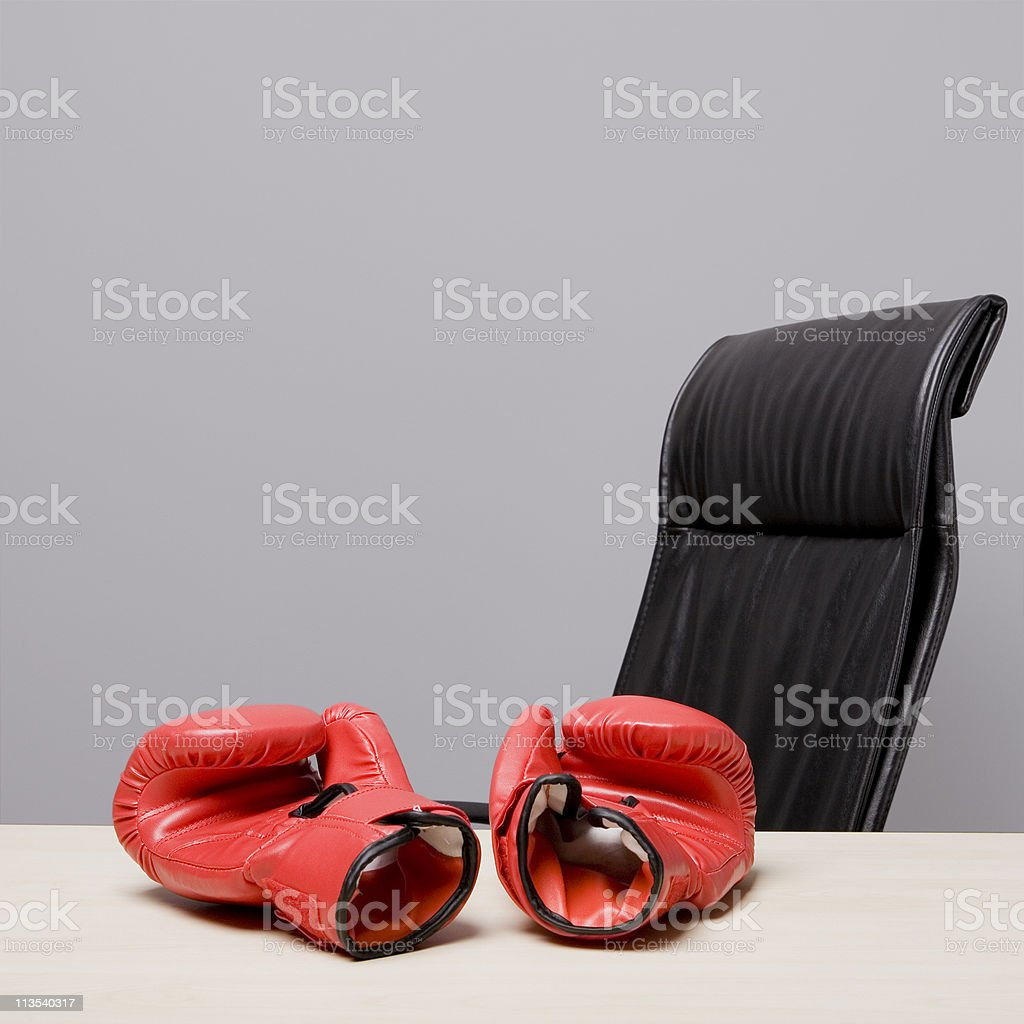 Boxing gloves on desk royalty-free stock photo