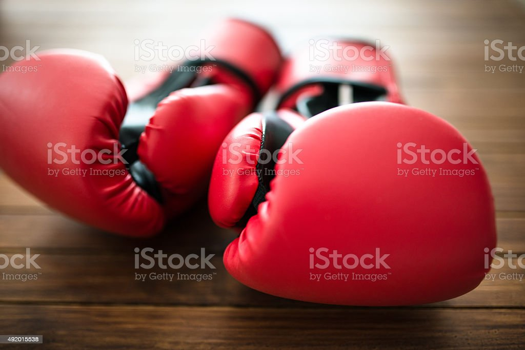 boxing gloves on plank wood stock photo