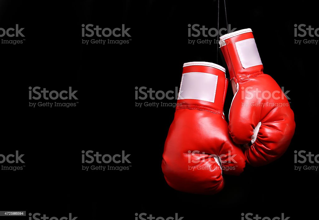 Boxing gloves over black stock photo