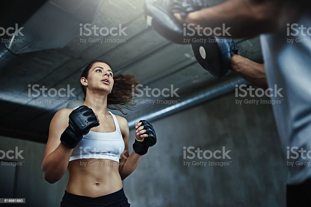 Boxing her way to a knockout body stock photo