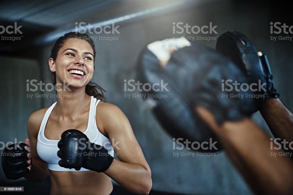 Boxing her way to a ripper body stock photo