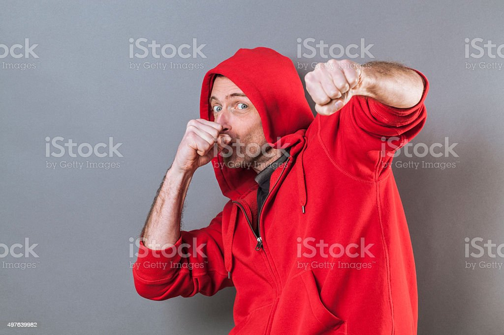 boxing man with a hoodie playing like a fun rapper stock photo